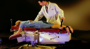 This is a picture of Cox Technic chiropratic spinal manipulation as performed at Satterwhite Chiropractic.